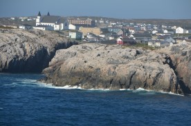 Channel-Port aux Basques stretching out behind the rocky shore