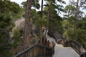 Very nicely done stairs and landings meander through the rocky forest.