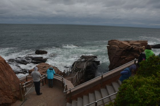 Thunder Hole. Below is a cave which makes a thundering sound when the water is at the right height and depending on the wave action.