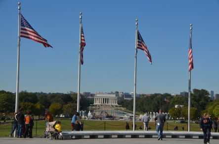Marble bench and flags encircle the base.