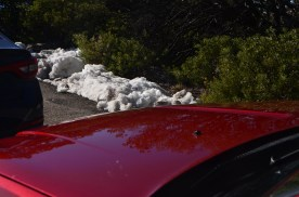 A little snow piled to the side of the road.