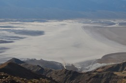 Looking down at Badwater. Where people have walked the salt crystals are smoothed out and it appears creamy colored.