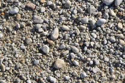 Ten feet higher on the beach less sand, more pebbles.