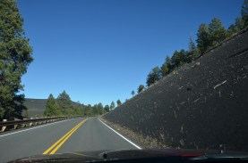 Cinder cone comes down to meet the nice smooth country road.