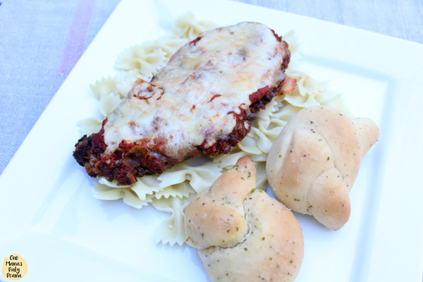chicken parmesan with pasta and bread