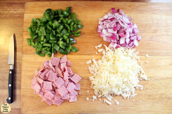 Italian quesadilla ingredients: peppers, onions, provolone, and ham