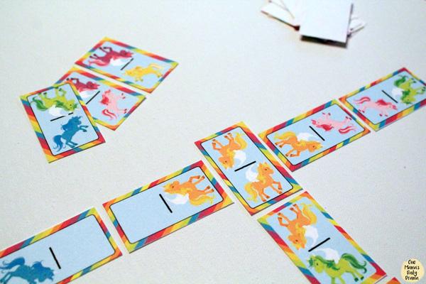 Rainbow unicorn dominoes crossing