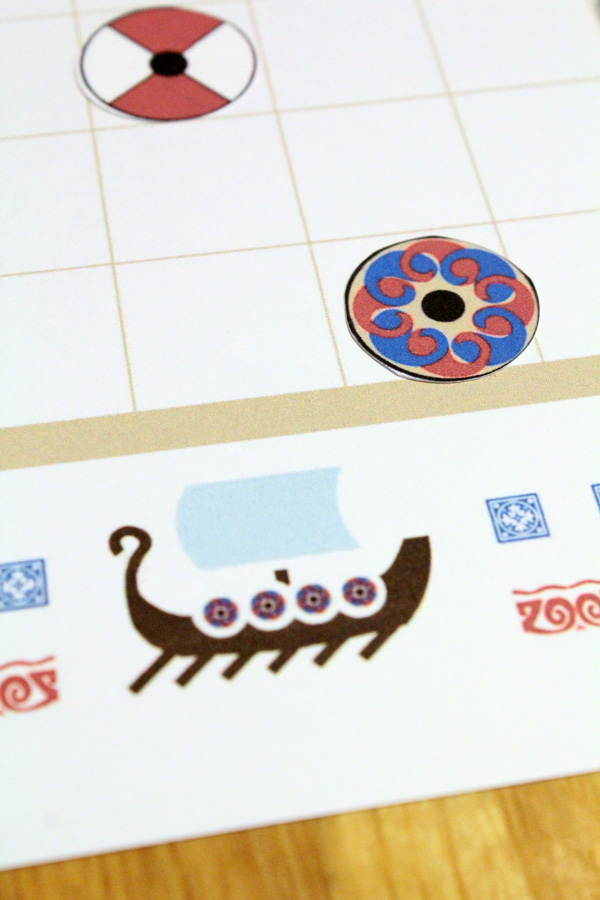 Tafl board game close up of viking ship motif on border