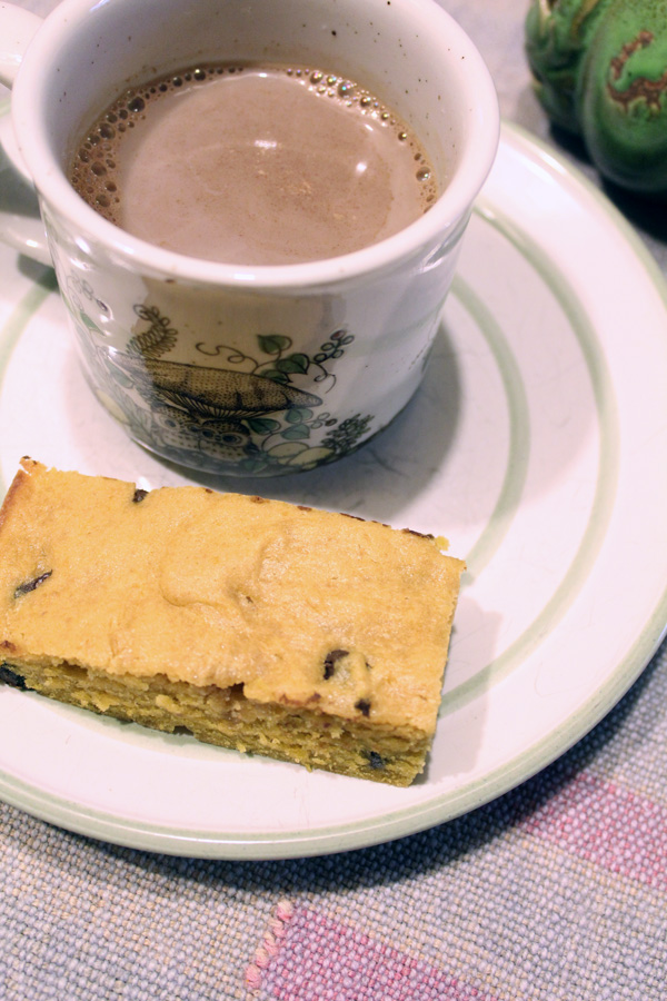 Pumpkin chocolate chip cookie bars go well with a mug of hot cocoa