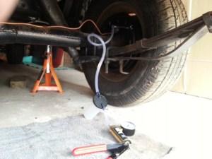 Brake bleeder connected to the rear wheel