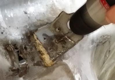 bracket being drilled