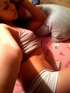 Miley Cyrus (aka Hanna Montana) Nearly Naked in Bed