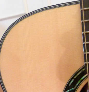 Kathy Wingert Model F Custom - Alpine spruce top detail - guitar review at onemanz.com