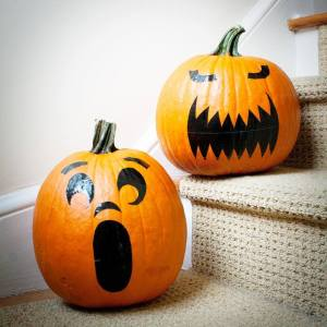 """Duct Tape Jack O Lanterns with """"stickers"""" made from duct tape."""