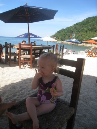 Snack time at our favorite beach spot (looking so grown up!)