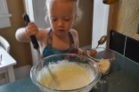Multi-tasking: adding flour and then mixing it in