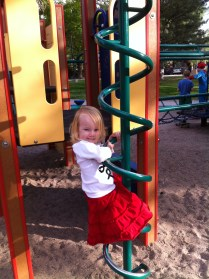 "Mastering the swirly slide-down bar...Now she says, ""Mama, don't help me. Stand waaaaay over there!"""