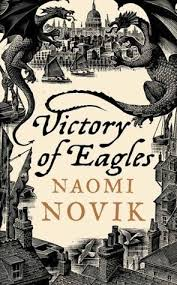 Book cover: Victory of Eagles - Naomi Novik (UK hardcover, stylised woodcut design of London and dragons)