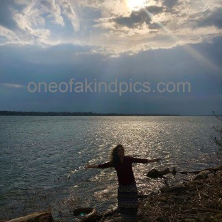 one of a kind photos P6000 Lady Basking Beside Niagara River USA In the Spring 3023 x 4032