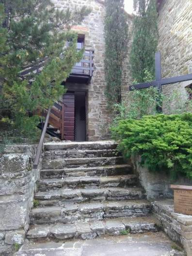 Entrance to the monastery chapel. Nuns go in the first floor, guests go up the stairs and sit in the cheap seats.