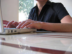 Photo of person typing, by Sascha Pohflepp, via Flickr