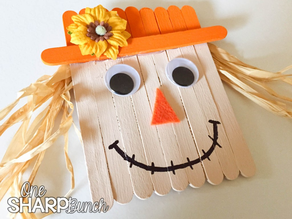 Create this simple fall DIY popsicle stick scarecrow for a super cute fall craft for kids!