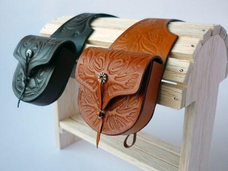 Dark brown and tan saddlebags with embossed rose or flame detail