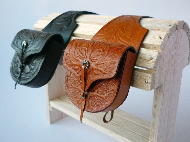 Dark brown and tan saddlebags with embossed rose or flame detail