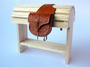 Tan saddlebags with embossed flame detail