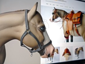 Cricket wearing a grey fabric halter made from findings