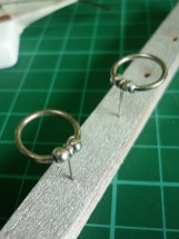 Jump ring with beads and a wire to make a snaffle bit, superglue is required!