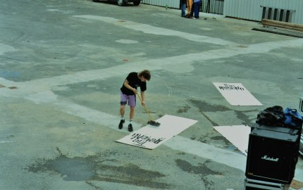 Cleaning the banners. Scrub it, Andy, scrub it!