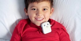 Bedwetting alarms attached onto a boy's pajama top