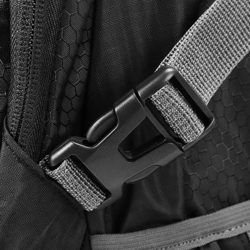 A close up of the main buckle on travel backpack