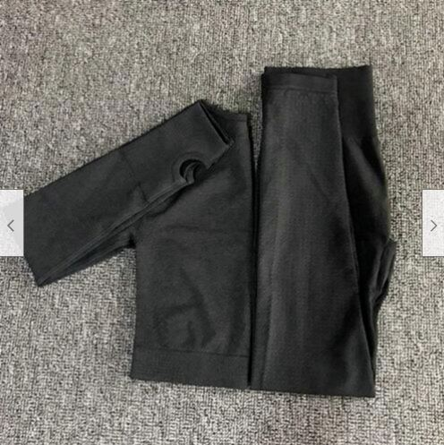 Top and yoga pants folded in black