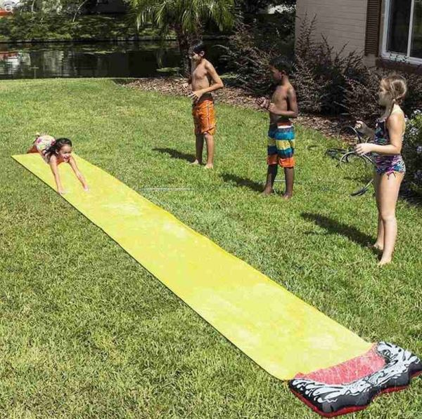 Four children playing with water slide