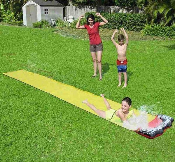 Three kids playing on yellow water slide