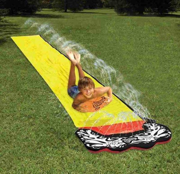 A boy sliding down a water slide