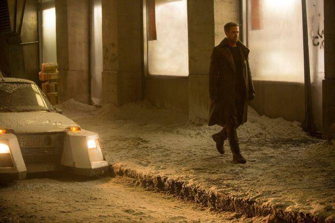 K (Ryan Gosling) walks the beat in Blade Runner 2049. Image via Inverse | Blade Runner 2049 movie review | onetakekate.com