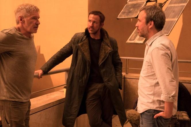 Harrison Ford, Ryan Gosling and Denis Villeneuve on set on Blade Runner 2049. Image via Collider | onetakekate.com
