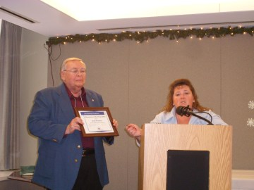 Neil Zurcher presenting scholarship to Lynda Nemeth of WRTC who accepted for Jacob Fradotte