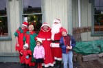 Santa and wife pose with helpers and visitors to Jefferson Railroad Station