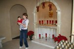 Tour guide Kathleen Conrad and Grandson Zach in front of replica alter in cave