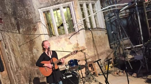 Daisy Vaughan performs in the Poltimore House covered courtyard