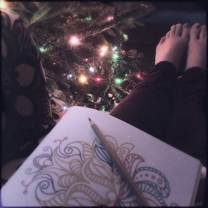 a photo of me, a coloring book, and the christmas tree