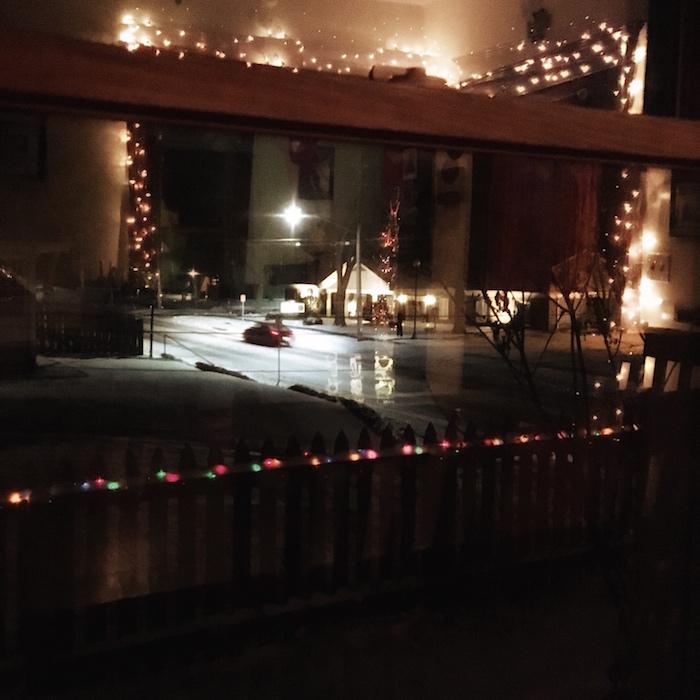 photo of christmas lights through window