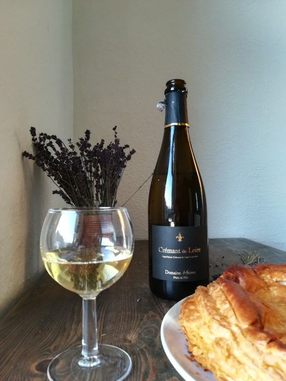 bottle of cremant du Loire with a Galette du Rois