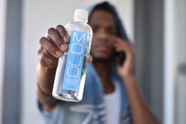 Shawn B holding Mojo Water