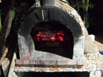 Pizza cooking in the brick oven.