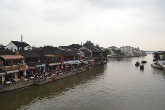 "I read a sign in my hostel's elevator, claiming Zhujiajiao to be ""Shanghai's Venice."" Said something along the lines of enjoy a day outside of the city, enjoy a relaxing time in the tranquil Zhujiajiao. I immediately scoffed, as it's virtually impossible to avoid people, especially in touristy places."